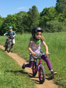 Mommy bloggers and their kids learn how to mountain bike.